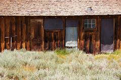Duplex (nedlugr) Tags: california ca usa bodie ghosttown doors window weathered weatheredwood corrugated ruraldecay rust ruralwest easternsierras sagebrush