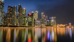 Marina Skyline Night (henriksundholm.com) Tags: skyline city urban cityscape marinabay night bluehour dusk skyscrapers singaporeriver river lake reflections shadows fullerton hotel cliffordpier hdr singapore southeast asia