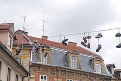 Hanging shoes in Ljubljana (George Pachantouris) Tags: slovenia europe ljubljana european medieval architecture shoes ljubljanica