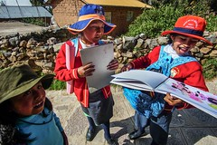Local kids showing us proudly their masterworks after school on Amantanì Island, Titicaca Lake. (dvdcrst) Tags: kids children peru colours titicaca lake people