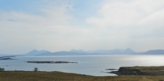 Isle of Skye Mountains from near Culduie, West Coast of Scotland, May 2017 (allanmaciver) Tags: island skye cuillin red black knoydart panorama sea shades hazy clouds calm simmer allanmaciver