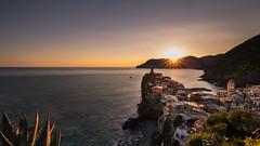 Vernazza sunset (Enrico Cusinatti) Tags: acqua barca boat clouds cielo enricocusinatti italy italia liguria viaggi mare orizzonte cinqueterre rocks rays sea sky sunset scogli sun sole travel tramonto vacation vernazza