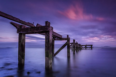 Sunset over HawkCraig Pier, Aberdour, Scotland. (Gary Alexander landscapes) Tags: hawkcraig pier aberdour absolutelystunningscapes angle atmosphere atmospheric art blue purple beach beaches canon colour color cloud clouds colourful density dark deep exposure edit long golden scotland section sky sea sunset s 2017 lee big stopper surreal dramatic dream iso 400 water landscape land rocks derelict abandoned explore