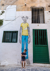 Lebanese kid standing in front of a giant dog painting in the street, South Governorate, Tyre, Lebanon (Eric Lafforgue) Tags: art artistic arty child colorimage concept conceptual creation dog funny house lebanon liban liban380 middleeast oneboyonly oneperson paint painted sour southgovernorate street streetart streetpainting tyr tyre vertical wall wallpainting lb libanon libano ливан レバノン لبنان