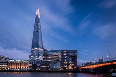 Across the Thames (Daniel Coyle) Tags: acrossthethames theshard theshardandno1londonbridge theviewfromtheshard london londonbridge no1londonbridge southwark southwarkcathedral stratase1 londonbridgehospital guyshospital guys river riverthames thames londonnight lights longexposure londonbluehour danielcoyle d7100 nikond7100 nikon clouds blur bluehour water night nightphotography nightshot nightonearth