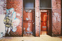 Street art, doors (paleyphotos) Tags: decay paint wall bars redhook york new newyork nyc color rusty rust metal iron brick doors door city graffiti brooklyn urban art street