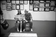 (Mamma Mia!) (Robbie McIntosh) Tags: leicam2 leica m2 rangefinder streetphotography 35mm film pellicola analog analogue negative leicam summilux analogico leicasummilux35mmf14i blackandwhite bw biancoenero bn monochrome argentique summilux35mmf14i autaut dyi selfdeveloped filmisnotdead strangers candid kodaktrix kodak trix fomadonexcel fomadon excel cosplay people woman girl f14 glow wideopen mariobros boy newspaper