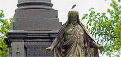 Sleepy Hollow, New York (Small Creatures) Tags: anamorphic cinemascope d60 delavan iscorama isco cemetery jesus bluebird nikkorh85mm nikond60 sleepyhollow monument sculpture perched