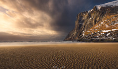 Remarkable Ryten (Ron Jansen - EyeSeeLight Photography) Tags: ryten lofoten kvalvika beach nordland norway winter snow cold wind sea ocean wave waves cliff mountain light clouds dramatic snowstorm rain ripple ripples wideangle nikonafsnikkor1424mmf28ged nikond810 eyeseelightphotographyronjansen colors hiking hike backpack top steep