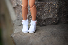white felt hand embroidered boots.