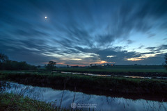 Moon, Newgrange and Mound B (mythicalireland) Tags: crescent moon lunar evening dusk waxing clouds river canal boyne valley meath newgrange monument mounds neolithic stone age reflection light landscape
