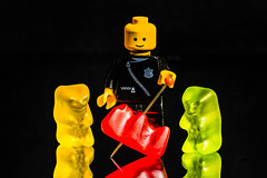 Rubber murder (Juergen Huettel Photography) Tags: crime macromondays jhuettel rubber red murder gummibären gummi police yellow green food