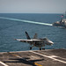 An F/A-18E Super Hornet lands on the flight deck of USS Carl Vinson.