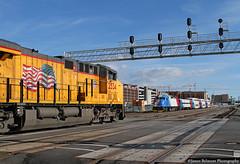 Freight Meets Commuter Rail (jamesbelmont) Tags: uprr uta freight passenger slc utah up up2534 uta3 train locomotive railroad city