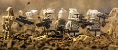 We hold them here! (Lego_LUTs) Tags: yellow blue green storm trooper star wars war lego outdoors clone troopers first order blasters afol minifigs minifigures bricks blocks canon toy toys force legos t3i republic people photoadd atst death rogue one dirt practical effects orange arc