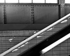 Hi there! (floressas.desesseintes) Tags: berlin schöneberg ubahn underground tube nollendorfplatz rolltreppe escalator bahnhof station mädchen girl jungefrau youngwoman streetfotografie schwarzweis