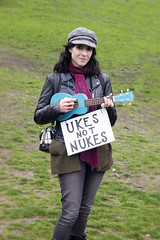 ukes not nukes (jim29028) Tags: marchforscience peace outside hat ukulele woman bostoncommon boston outdoors protest color scarf grass olympus oly fourthirds 43 zuiko zd 1260mm e5 portrait