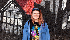 Jenna - stranger 079/100 (englishreader) Tags: 100strangers strangerphotography strangers stranger streetphotography street thehumanfamily people peoplephotography person portraiture portrait portraitphotography girl girls younglady youngwoman female sunglasses jacket bluejacket colour color colourful colours colors colorful graffiti wall blue black white red buildings paintedwall windows availablelight daylight naturallight primelens