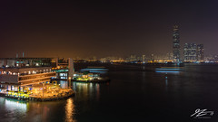 Them, On The Other Side (Tim van Zundert) Tags: internationalcommercecentre icc yaumatei kowloon harbour lighttrails night evening boats water longexposure skyscraper towers architecture building cityscape city skyline hongkong china sony a7r voigtlander 21mm ultron