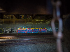 The Hidden View (Mildred Alpern) Tags: graffiti tunnel tracks chain wall light color rut gravel indoors