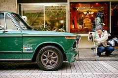 Yokohama sanpo moment (Eric Flexyourhead (catching up)) Tags: motomachi 元町 nakaku 中区 yokohama 横浜市 kanagawa 神奈川県 japan 日本 city urban street shoppingstreet detail fragment german car bmw 2002 bmw2002 bmw2002ti green sonyalphaa7 zeisssonnartfe55mmf18za zeiss 55mmf18