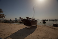 The Boats (azahar photography) Tags: arab background bahrain beach blue boat brown coast color dried dry eating fish fishery fishing food gcc gourmet gulf harbor head land maintenance manama meal muharaq natural nature nobody ocean old repair sail sailboat salt salted salty sea seafood silhouette sky snack stockfish storage tasty tradition traditional travel tree vessel view vintage water white wood wooden