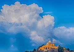 Clouds Over The Volcano And Cholula's Church (Cholula, Puebla, Mexico. Gustavo Thomas © 2017) (Gustavo Thomas) Tags: nubes clouds sky cielo volcano volcán popocatepetl blue yellow church iglesia cholula puebla méxico mexican