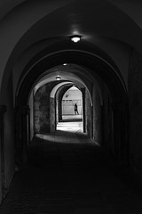 He's late! (David Feuerhelm) Tags: blackandwhite bw nikkor contrast corridor atmosphere atmospheric figure lonely canterbury cathedral nikon d750 arch distant silverefex