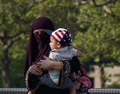"""You'll be my American boy"" - Estelle (Lidiya Nela) Tags: brightonbeach love sonya6000 sony street streetphotography city urban coneyisland brooklyn newyorkcity nyc boardwalk son mother candid people hijab niqab"