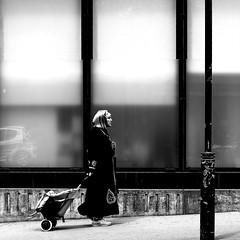 The woman in the long coat (pascalcolin1) Tags: paris13 femme woman manteau coat windows vitres caddie photoderue streetview urbanarte noiretblanc blackandwhite photopascalcolin