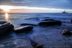 St Mary's Lights (sidrog28) Tags: rocks sun lighthouse rock long exposure newcastle dawn nikon photography sky sunny