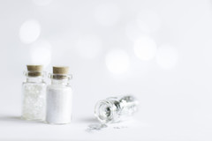 20/52: Fairy dust and sparkles... (judi may...mostly off until mid July) Tags: 52weekchallenge sparkle highkey bokeh white whitebackground bottles glitter stars negativespace dof depthoffield sparkly simplicity minimal minimalism less lessismore canon7d 50mm stilllife
