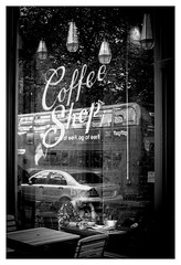 Coffee shop - in explore (Dave Fieldhouse Photography) Tags: birmingham monochrome blackandwhite street streetphotography urban shop coffeeshop reflections westmidlands portrait fuji fujifilm fujixpro2 people city public coffee bus mercedes publictransport lanterns shopfront store