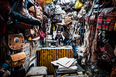 The leather tailor (superUbO) Tags: marrakech tailor leather sewingmachine portrait suk marocco street bags work color man eyes tosew superubo reportage streetphotography city old culture