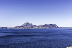 Helgelandskysten (Einar Schioth) Tags: helgelandskysten helgeland water sky sea sunshine day canon coast cliff clearsky blue bluesky nationalgeographic ngc norway norge nature mountains mountain landscape outdoor photo picture einarschioth
