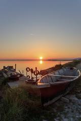 Un alba (Luca Maresca) Tags: alba barche gargano lagodilesina lake lesina puglia weareinpuglia acqua sole doppiaesposizione verticale lago