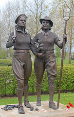 National Memorial Arboretum. Memorial to the Women's Land Army and Women's Timber Corps (Explore(d)) (Lark Ascending) Tags: nationalmemorialarboretum alrewas staffordshire memorial womenslandarmy womenstimbercorps bronze statues sculpture pitchfork women uniform soldiers