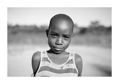 Malawi Africa Portrait (Vincent Karcher) Tags: vincentkarcherphotography africa afrique art blackandwhite culture documentary malawi noiretblanc people portrait project rue street travel voyage world photography kid children child enfant beauty village