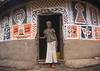 Ethiopian woman standing in front of her traditional painted house, Kembata, Alaba Kuito, Ethiopia (Eric Lafforgue) Tags: abyssinia adult africa alaba architecture art building circular color culture decorated decoration depiction eastafrica ethiopia ethnic fulllenght geometric halaba home horizontal hornofafrica house hut illustration islam kulito lookingatcamera mural muslim oneperson onewomanonly outdoors painted painting poverty residential round ruralscene toukoul traditional tukul village woman women ethio163445 alabakuito kembata