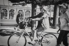 63+520: Girl on a bicycle (geemuses) Tags: girl women bicycle past present future manlybeach beachfront beach riding bike cycling nsw australia exercise bandw black white blackandwhite monochrome action street streetphotography