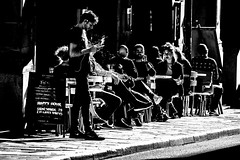 Cool late afternoon (andersåkerblom) Tags: urban city street sittning bar group people smoking monochrome blackandwhite