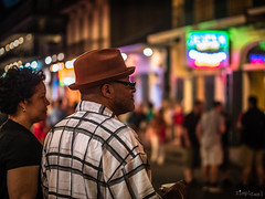 Checking the Vibe (SimplSam) Tags: neworleans panasoniclumixg7 street usa people night watching hat glasses colourful nocticron leica bokeh nola p1350163