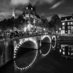 Time moves slow (McQuaide Photography) Tags: amsterdam noordholland northholland netherlands nederland holland dutch europe sony a7rii ilce7rm2 alpha mirrorless 1635mm sonyzeiss zeiss variotessar fullframe mcquaidephotography adobe photoshop lightroom tripod manfrotto light licht night nacht nightphotography longexposure stad city capitalcity urban lowlight architecture outdoor outside old oud gracht grachtenpand canalhouse house huis huizen traditional authentic water reflection gebouw building waterfront waterside canal wideangle groothoek keizersgracht astoria bridge brug arch illuminated jugendstil history historic historicalbuilding tower blackandwhite bw mono monochrome