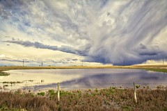 Clouds are cool (John Andersen (JPAndersen images)) Tags: bowriver calgary clouds farming pond rain skyline spring storm sunset tractor urban yyc