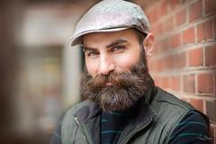 Pablo [Stranger #38/100] (Vijay Britto Photography) Tags: red reflector 100strangers beard personality naturallight outdoorportraits men cap nikon d750 85mm 18 look