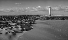 standing at the edge of tides (lunaryuna) Tags: uk england merseyside wirralpenninsula wallasey newbrighton perchrocklighthouse newbrightonlighthouse beach urbanbeach sand textures coast clouds light season winter strangewinter lunaryuna blackwhite bw monochrome