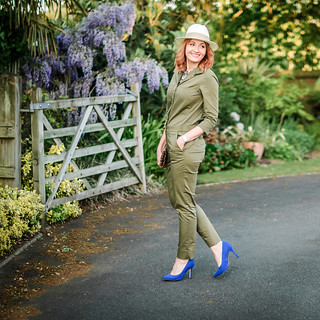 What to wear with a safari-style khaki jumpsuit: Cream fedora \ statement crystal necklace \ cobalt blue heels \ leopard clutch | Not Dressed As Lamb, over 40 style