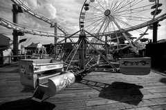 the scrambler. santa monica, ca. 2007. (eyetwist) Tags: eyetwistkevinballuff eyetwist santamonica santamonicapier pacificoceanpark pier rides scrambler ferriswheel rollercoaster tiltawhirl bw blackwhite black white monochrome 35mm nikon f3t tokinarmc17mmf35 tokina rmc 17mm wide wideangle superwide manualfocus efke efke100 r100 analog analogue ishootfilm emulsion losangeles los angeles la angeleno california pacific ocean believeinfilm amusementpark carnival fun westcoaster nikonf3t