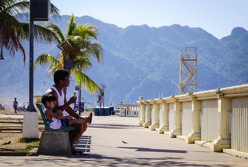 People sitting at seaside park