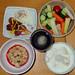 #2215 breakfast: granola, hot coffee, yogurt with banana, veggies, poached egg, chicken wiener